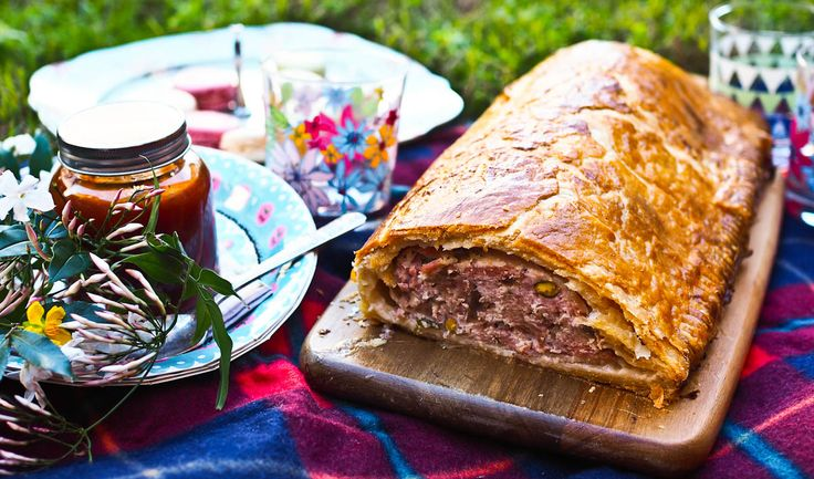 This pork and pistachio sausage roll is a little bit special Dear Reader. It's partly a pork and pistachio terrine and partly a sausage roll. With a buttery home made puff pastry and brandy caramelised onions and seasonings, you wrap the filling in bacon and then bake it. To accompany it is a marmalade ketchup! It is the perfect centrepiece for Father's Day!