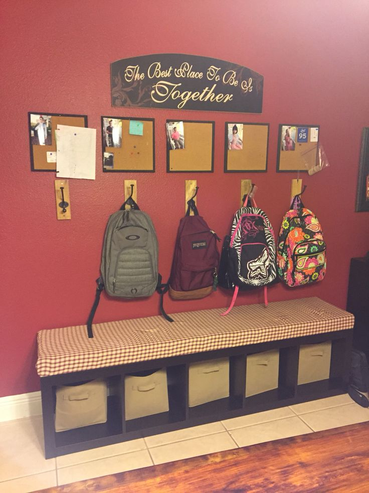 Backpack station, bulletin boards for each kid with their picture and pins for notes, mail, school papers etc. Ikea bookshelf laid on side for bench.