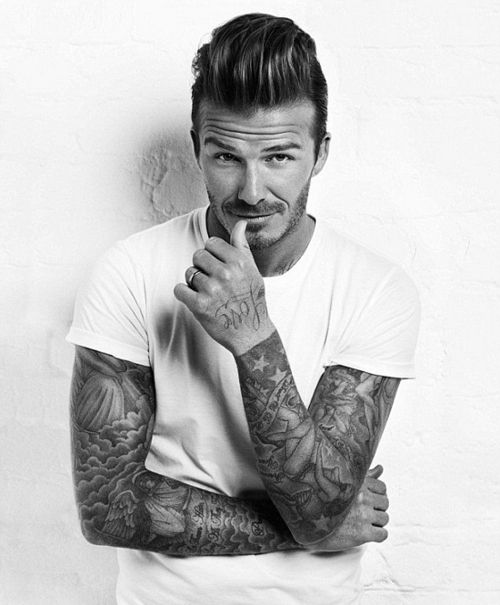 Note a huge David Beckham fan, but I can't resist a man with sleeves <3