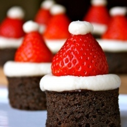 Santa hat brownies CUTE!  Though I feel these would be cuter on yellow cake.