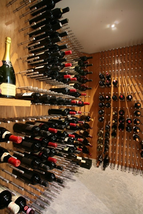 This is an interesting way to build wine racks.  Could take up less space and be more easily expandable.