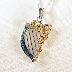 Our elegant Irish Harp Necklace is accented brilliant gold shamrocks is a noteworthy piece of Irish jewelry. The Irish harp, although not as renowned as the shamrock is the official emblem of Ireland. The Irish harps status as the official insignia of Ireland dates centuries and the elegant instrument's history tells much about the history of the Emerald Isle.