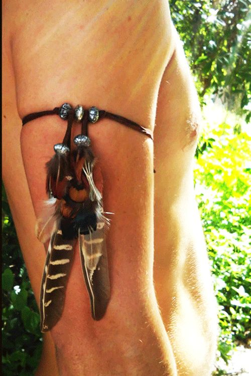 Run through the forest and feel your connection to the great beings who dwell there, with this mixed feather and bead armband...bring out your tribal heartbeat....vegan faux leather band. by Diesel Bo