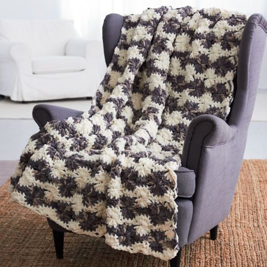 Crochet a super-cozy blanket with super-bulky Bernat® Blanket™. This chenille-style yarn is per...
