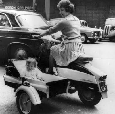 lambretta scooter with baby's sidecar. look ma! no helmet! lol and probably no seatbelt either.
