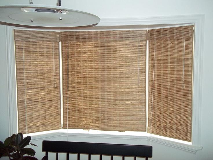 enclosed bay window with bamboo shades