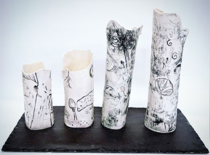 """""""Four in a slate"""" series of porcelain paper clay vessels inspired by fungi and mushrooms, made with recycled paper fibres printed with plaster slabs, and black slip , Slab rolled and finish with platinum lustre. Displayed on a slab of slate (found object) Each piece intends  to look damage or broken to represent the imperfections in life and nature"""