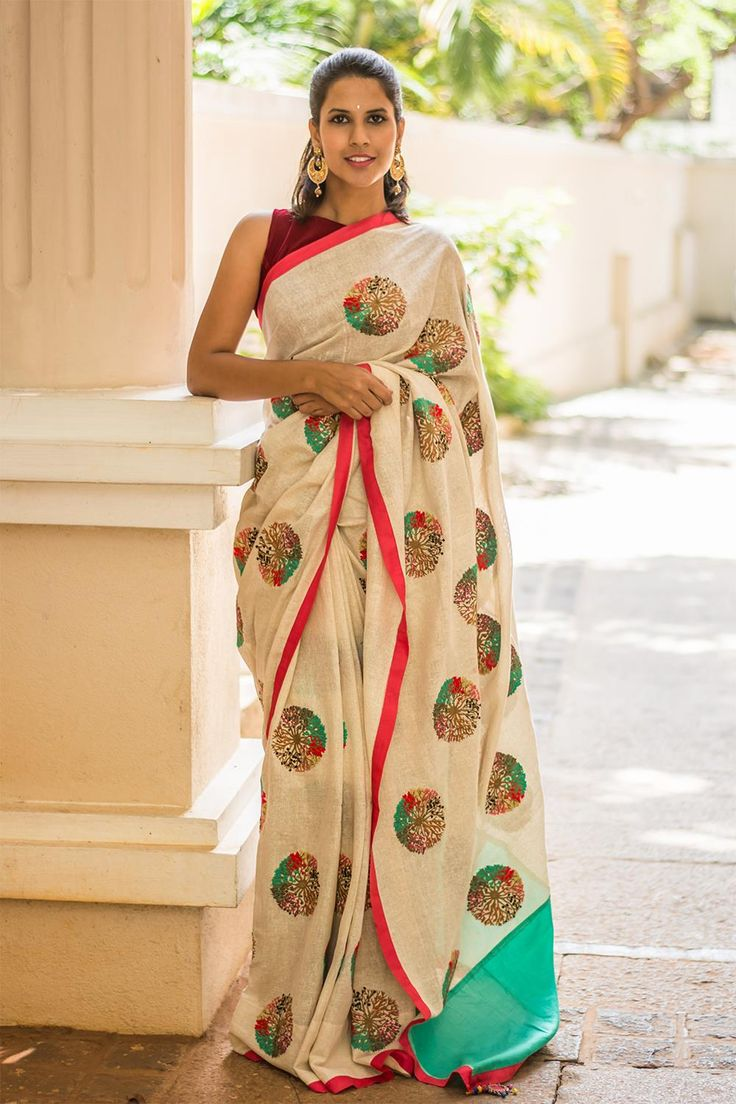 Want to play with colors but afraid to go over-board? Yes, then this is the right pick for you! A simple cream coloured saree with quirky coloured work shows how to balance colors the right way. A contrast pastel green delivers just the amount of quirkiness you need. Match the red border with red blouse and minimal makeup, and you are good to go.. #offwhite #multicolor #embroidery #saree #India #blouse #houseofblouse