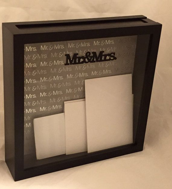Many brides and grooms set out a basket to collect cards at their wedding, but you can be unique with this beautiful Mr. & Mrs. card holder for