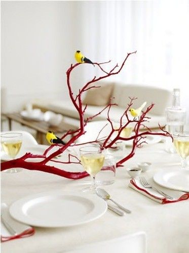 painted tree branches as table decoration