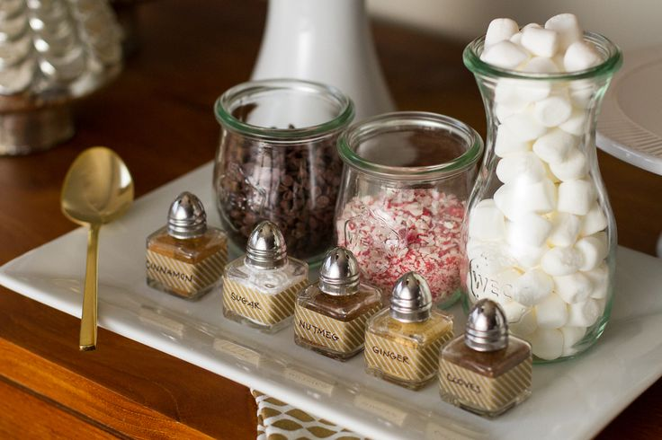DIY hot cocoa bar for the holidays! Organizing your toppers in various glass jars makes for a pretty presentation