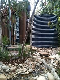 Australian native garden - like the rocks, trees & grass plants