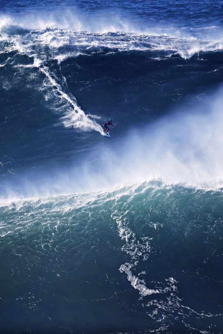 """ A surfer rides a big wave during a tow-in surfing session at the Praia do Norte or North beach, in Nazare, Portugal, Saturday, Nov. 29, 2014. (AP Photo/Francisco Seco) """