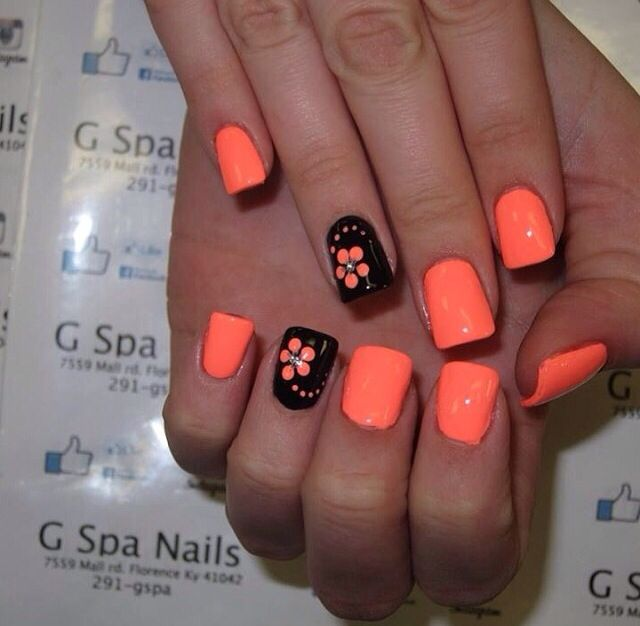 Neon orange nails black with flower
