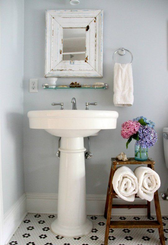 3. A step ladder is the perfect size for an awkward space between the sink and toilet and doubles as towel storage. From Eclectically Vintage.