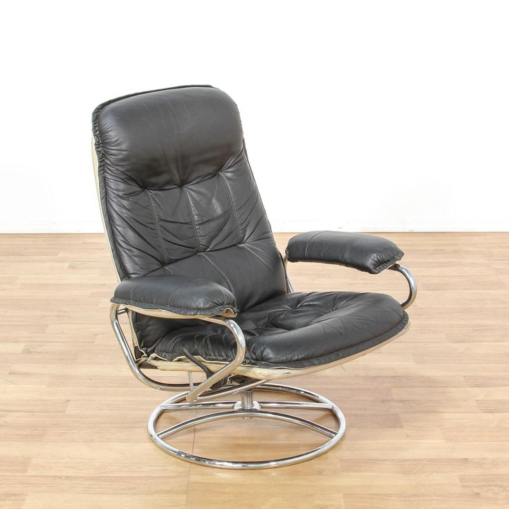 This contemporary armchair is upholstered in a durable vinyl with a shiny black finish. This recliner has a tall reclining back, cushioned arms and a shiny chrome swivel base. Sleek and modern piece perfect for lounging! #contemporary #chairs #armchair #sandiegovintage #vintagefurniture