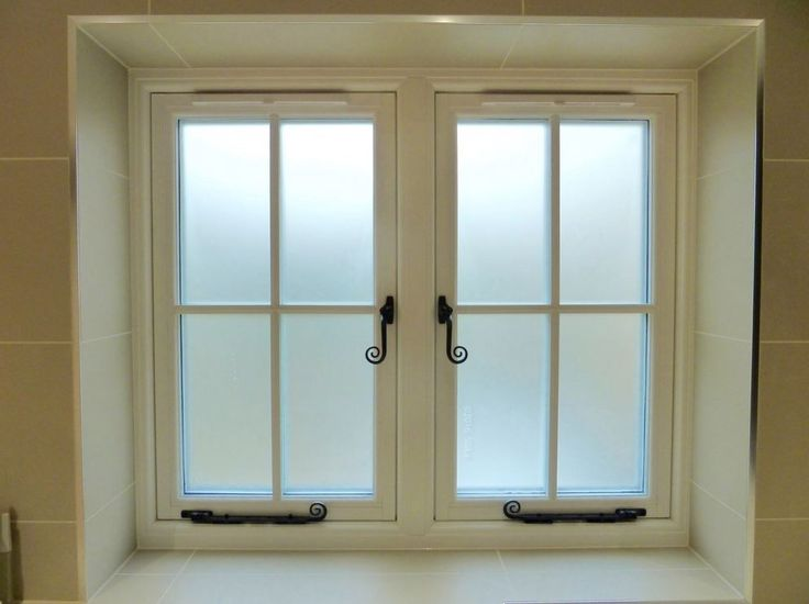 Residence 9 inside photo of grained white windows with monkey tail handles and monkey tail peg stays