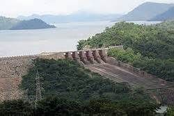 The Akosombo Dam, also known as the Akosombo Hydroelectric Project, is a hydroelectric dam on the Volta River in southeastern Ghana in the Akosombo gorge and part of the Volta River Authority. The construction of the dam flooded part of the Volta River Basin, and led to the subsequent creation of Lake Volta.