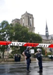 """Authorities say an assailant wielding a hammer attacked Paris police guarding  Notre Dame Cathedral, crying """"This,  is for Syria"""" before being shot and  wounded by officers outside one of  France's most popular tourist sites   Man attacks Paris police with tool at Notre Dame 'for Syria'NowThe Associated Press — By PHILIPPE SOTTO And ELAINE GANLEY - Associated Press  1/13  PARIS (AP) — An assailant wielding a hammer attacked Paris police guarding Notre Dame Cathedral Tuesday, cryin"""