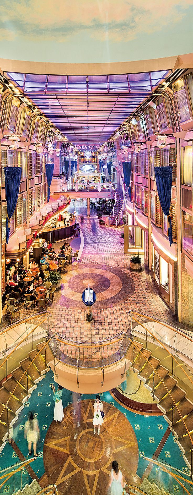 Mariner of the Seas. Parades, dancing, shops and bars—all before you even leave the ship.