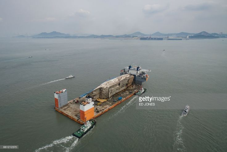 Salvaged Sewol Ferry Transported To Mokpo Port