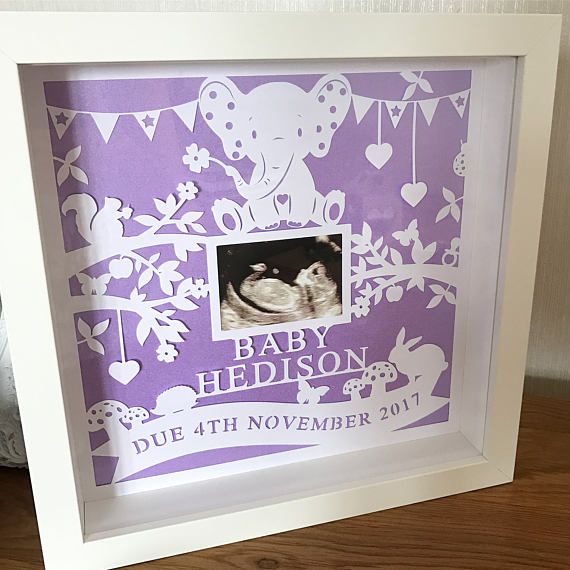A stunning personalised baby scan papercut!  *PLEASE NOTE* This papercut has been designed specifically to fit into an IKEA Ribba 23cm x 23cm frame, so if you choose to purchase this item unframed, you will need to purchase the frame from Ikea or source a similar frame with the same dimensions. Please find the link to the Ikea frame here - http://www.ikea.com/gb/en/products/decoration/frames-pictures/ribba-frame-white-art-00078032/ My additional fr...