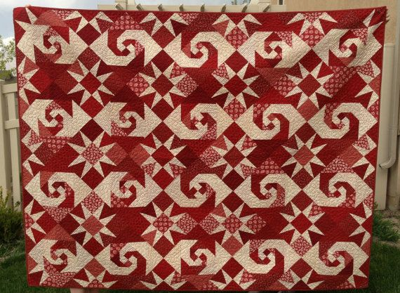 Red & White Snail Trail With Star Quilt. This quilt is made with beautiful red and white civil war fabric.