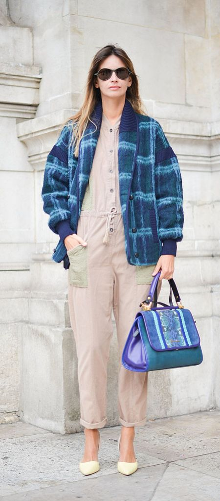 A plaid bomber jacket and a neutral jumpsuit