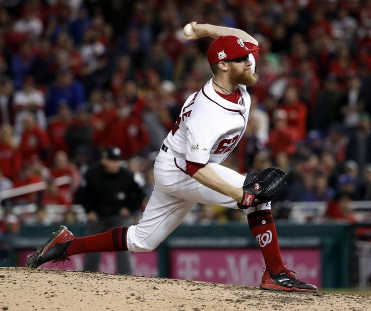 October 12, 2017:  NLDS Game 5: Cubs vs. Nationals  -   The Chicago Cubs defeated the Washington Nationals, 9-8.  Washington Nationals relief pitcher Sean Doolittle throws during the ninth inning in Game 5 of baseball's National League Division Series against the Chicago Cubs, at Nationals Park, early Friday, Oct. 13, 2017, in Washington.