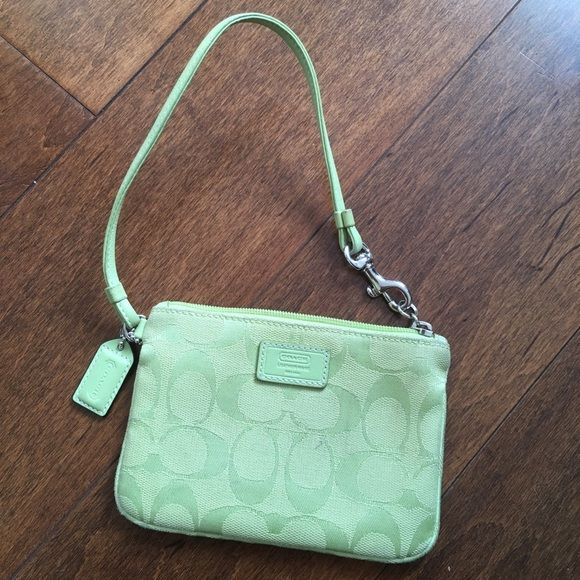 Like new mini Coach wristlet Light green, small Coach wristlet. No stains, scratches, pet free and smoke free home. Like new condition. Coach Bags Clutches & Wristlets