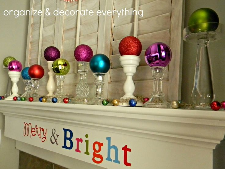Merry & Bright Mantel - Organize and Decorate Everything. Bright ornaments on top of candlesticks.