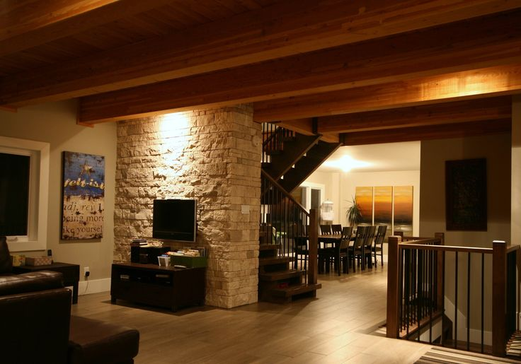 open concept space natural interior stone veneer exposed wood beams