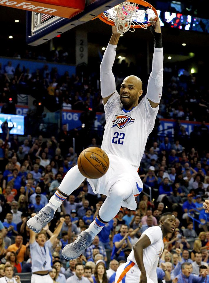 Oklahoma City's Taj Gibson (22) dunks the ball in the first half of an NBA basketball game where the Oklahoma City Thunder play the Golden State Warriors at the Chesapeake Energy Arena in Oklahoma City, on March 20, 2017. Photo by Steve Sisney The Oklahoman