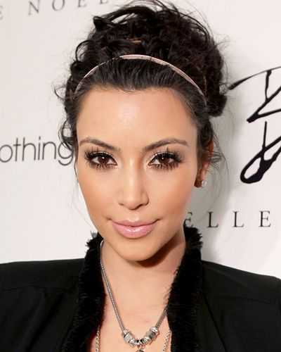 """STAY COOL TIP Even glam girls take a breather in the muggy months. Take this spirited bun Clyde Haygood created for Kim Kardashian. """"Kim usually doesn't go for messy hair, but this style is versatile enough to transition from poolside to a night out,"""" he says. Haygood started by applying styling mousse to damp hair, then pinning it into a messy French twist. """"The mismatched elastic headbands give the style personality while keeping hair in place"""