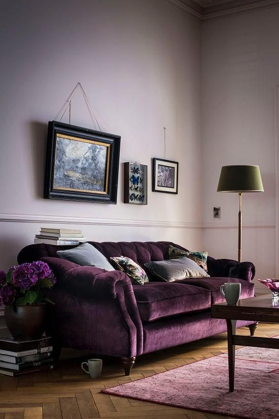 SeasonsinColour | The best 20 Velvet Sofa looks {October 2015}  PURPLE DELIGHT   I find lilac walls quite relaxing and so I can imagine reading a good (interiors) book on this sofa. A great room with a few and eclectic pieces of art (love the butterfly collection). And just look at the green lampshade next to this amethyst like sofa from Arlo and Jacob!