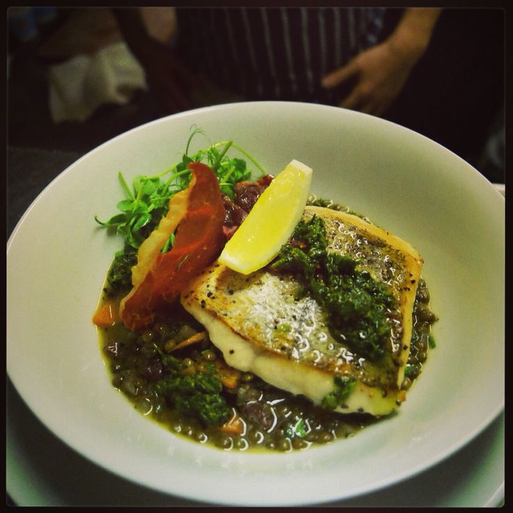 Merluzzo Pan seared hake fillet, served on a bed of lentils cooked with soffrito with pancetta and dressed with salsa verde.