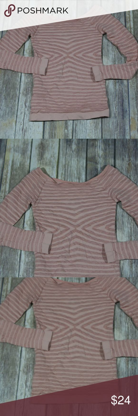 """Free People Seamless Optical Off The Shoulder Top Free People Women's Seamless Optical Stripe Off the Shoulder Top.  Size Medium/Large.  Light pink (rosette).  Raised stripes have a metallic sheen.  92% nylon, 8% spandex.  Machine wash.  Item appears to be new with tags, retailing at $48.  No flaws noted.  Style F734F191.  No trades, offers welcome.  Measures 12"""" pit to pit, 19"""" top of shirt to hem. Free People Tops Tees - Long Sleeve"""