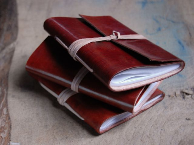 These luxurious classic slim handmade small leather wrap journals have been handcrafted using traditional leather craftwork and book binding skills. Each contains 40 pages (80 sides) pages of handmade paper made from recycled cotton, which creates a unique texture that is suitable for most pen types (not fountain pens) and sketching. £6.50