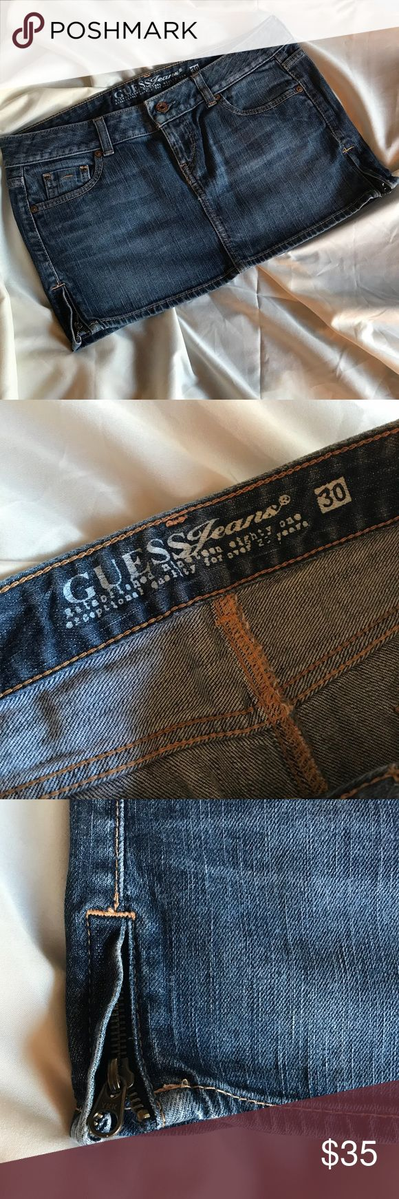 Guess Denim Mini Skirt 💋 Get ready for warm weather and skirt season! This Guess skirt is made of quality denim, a beautiful dark wash color and size 30. It has cute side zipper details and the legendary Guess logo in the back. It's like new and ready for action. Please feel free to contact me with any questions.  *** My items come from a smoke free home with a dog. Open to reasonable offers 😊 Guess Skirts Mini