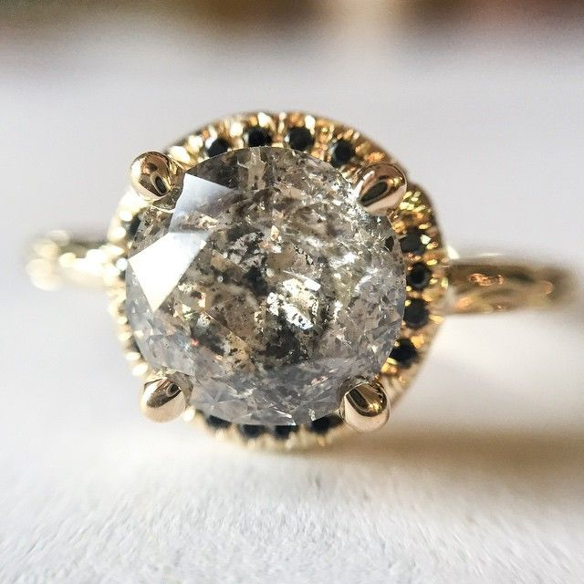 """""""Trying out a new pave technique with the Inigo ring. 14k yellow gold with 2 carat salt & pepper diamond and black diamond pave under setting."""""""