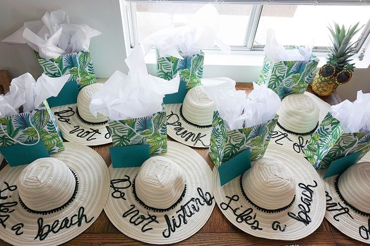 A Tropical Beach Bachelorette Party  | These DIY floppy beach hats with sayings like Do Not Disturb or Life's a Beach are the perfect bachelorette party favor for a beach bachelorette. Click to see the whole party! Ultimate Bridesmaid | Love Always, Audrey