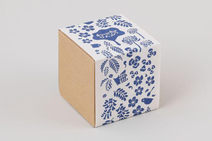 和一郎のはちみつ blue packaging belly band on cardboard box