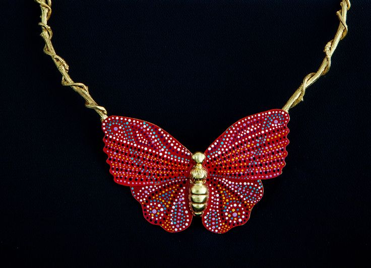 A detailed image of beautiful handcrafted gold-plated butterfly sitting on branches necklace inspired by nature, that could be worn all day long, from a morning meeting to a romantic dinner. Butterfly is all handpainted using a pointillism pattern. Explore our jewellery inspired by the nature wonders on http://www.facebook.com/LillysPapillon http://www.lillyspapillon.com