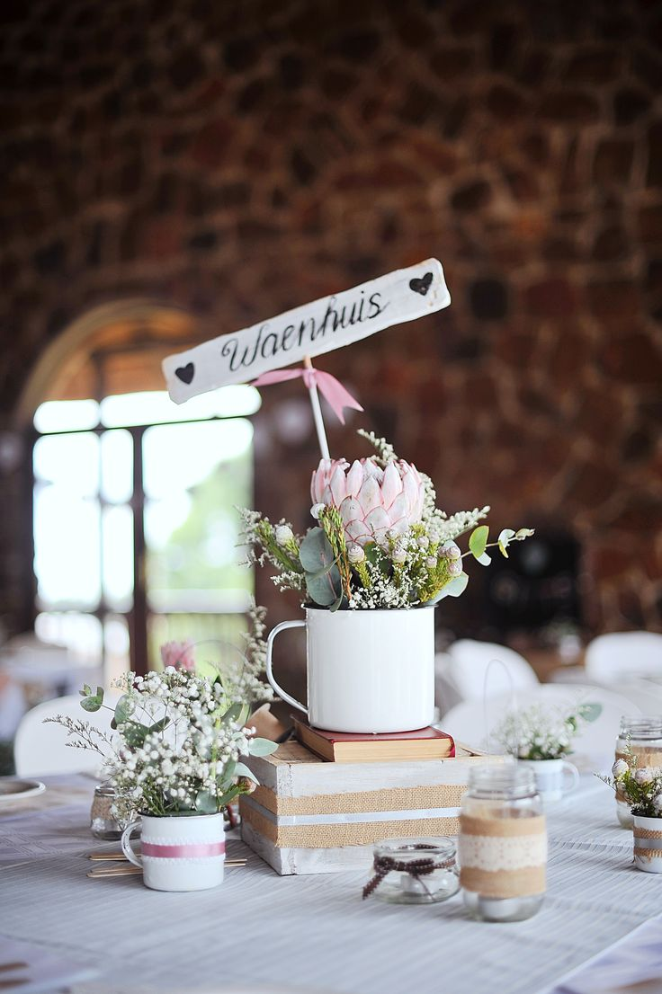 Love this table name ideas with this King Protea flower arrangement for a lovely vintage wedding.