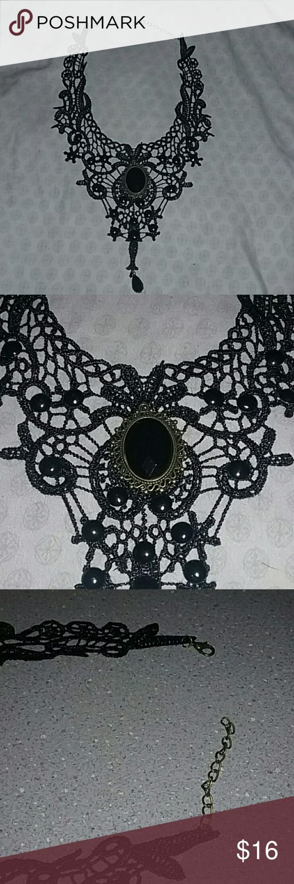 Black lace/crochet choker necklace #victorian #gothic #rocker #punk   Lobster clasp closure Black pendant with gold metal plating around it  The spots on the pendant is just from the flash/lighting. undefined Jewelry Necklaces