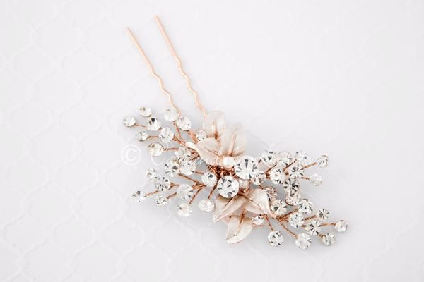 This stunning and radiant bridal hair pin is a simple design of sprays of crystals with a center of matte silver or gold leaves. Looking for a smaller addition