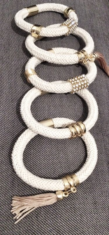 Beige cord bracelets with gold elements