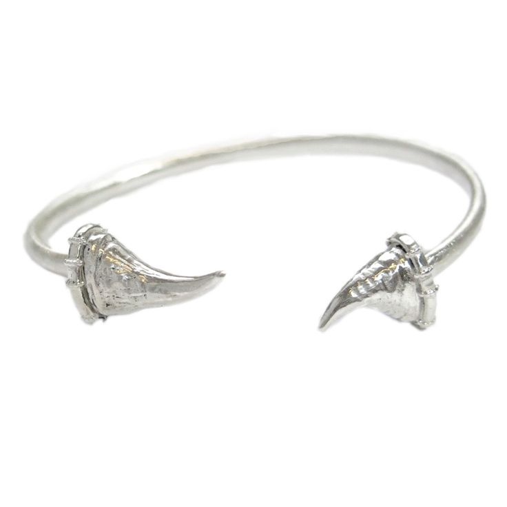 Sterling Silver Bangle     Horn 1 - 22mm length, Horn 2 - 16mm, bangle width 4mm  Weight - 21 grams     10% of this sale is donated to The Black Mambas Anti-Poaching Unit