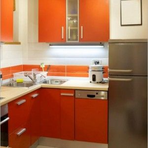 Kitchen Idea Cute Small White Kitchen Design With Orange Cabinet Large Chrome Refrigerator And White Kettle On White Countertops Wonderful Kitchen Design
