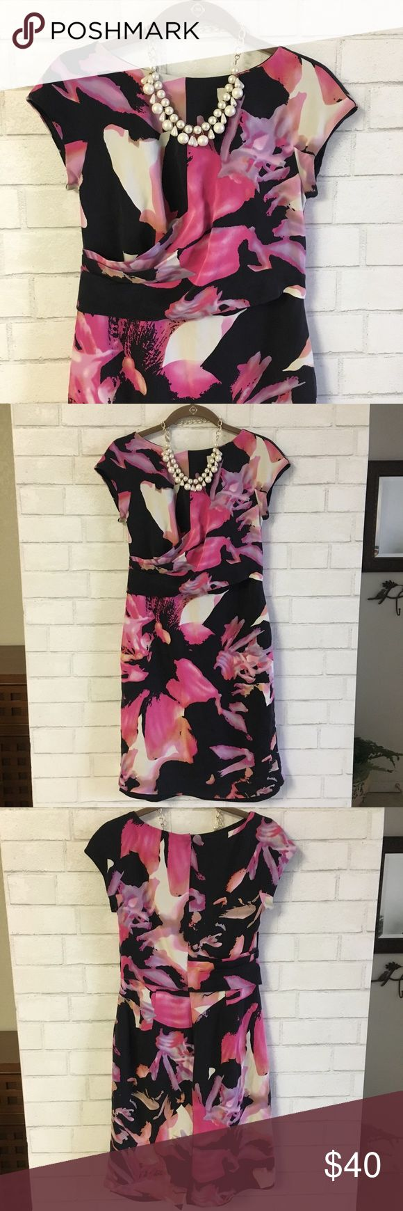 💜🌸🌺Stunning Ann Taylor Floral Dress🌺🌸💜 💜🌸🌺Stunning Ann Taylor Floral Dress🌺🌸💜 Perfect for any occasion or weekend fun! Has a beautiful Black, Pink, Purple, Lavender color scheme. This dress is lined, with pretty cap sleeves, a gathered waistline, zipper back closure and a slit in the back. Great condition. Comes from a smoke-free, pet-free home:)💕 Ann Taylor Dresses Midi